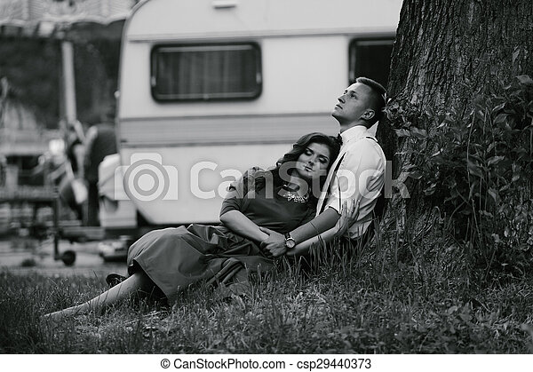man and woman under a tree - csp29440373