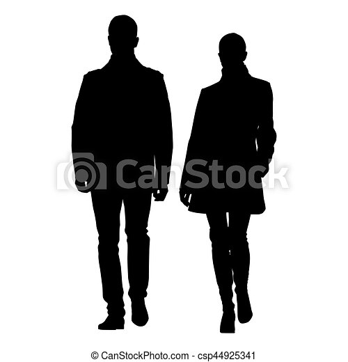 Man and woman walking side by side dressed in coats. Vector silhouette of young couple well dressed people - csp44925341