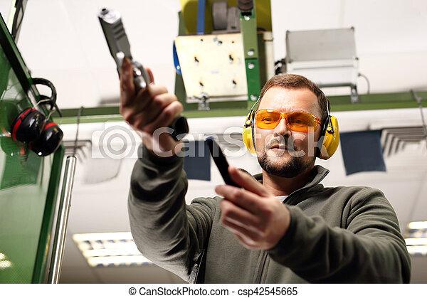 man at the shooting range. - csp42545665