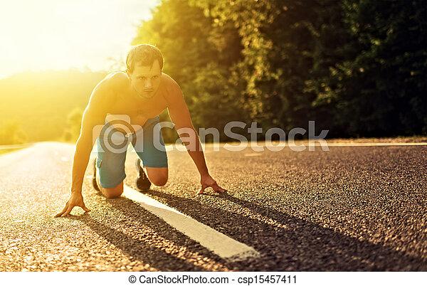 man athlete running on the nature at sunset  - csp15457411