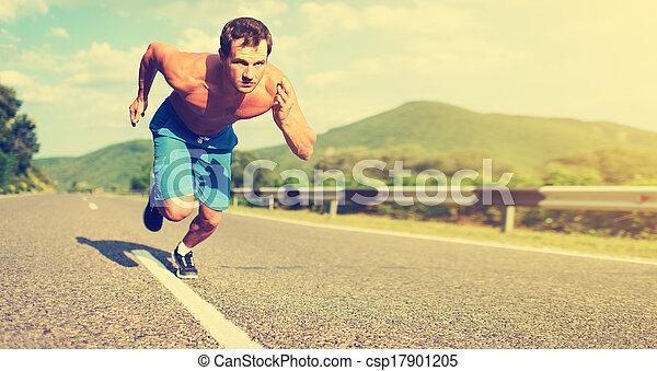 man athlete running on the nature at sunset  - csp17901205