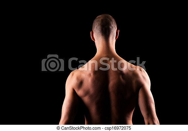 man back the muscles on a mans back over a black background