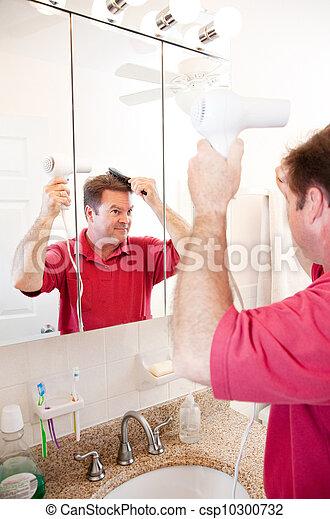 Man Blow Drying Hair in Bathroom - csp10300732