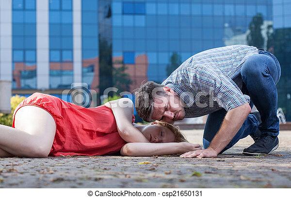 Man checking if woman's breathing - csp21650131