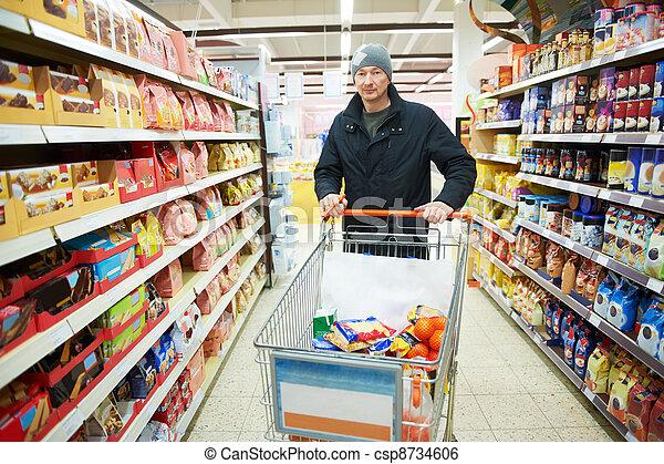 man choosing vegetables in supermarket store - csp8734606