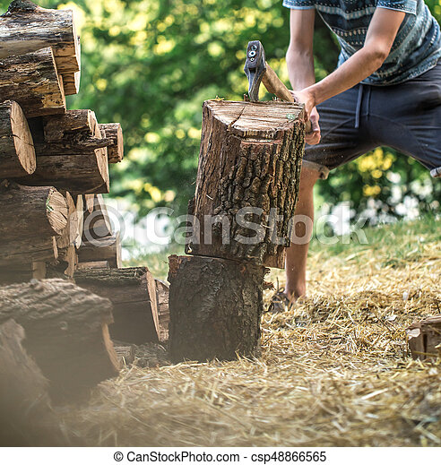 Man Chopping Wood With An Axe Close Up