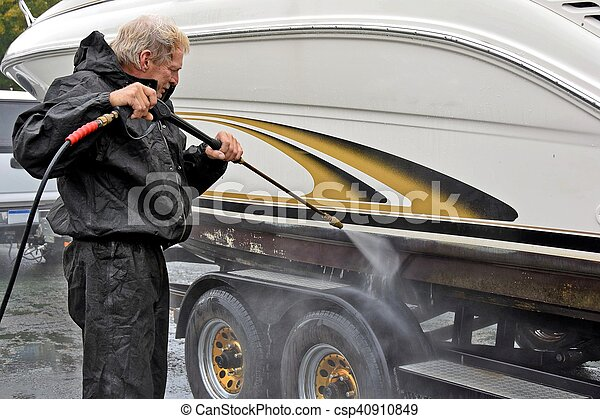 man cleaning boat hull - csp40910849