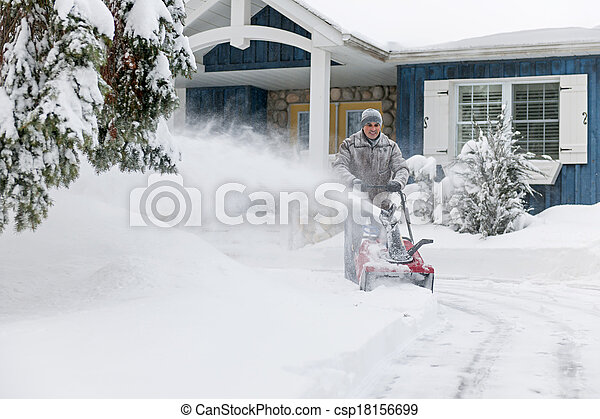 Man clearing driveway with snowblower - csp18156699