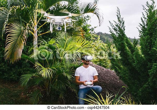 Man controls a quadrocopter - csp44247504