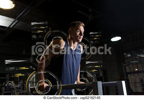man doing triceps dip on parallel bars in gym - csp52162145