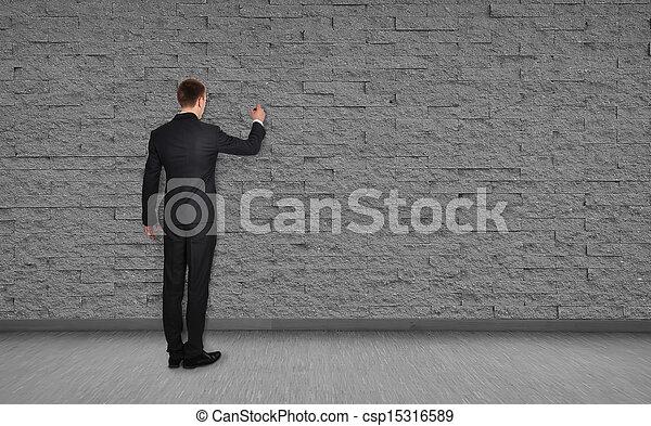 man drawing on wall - csp15316589