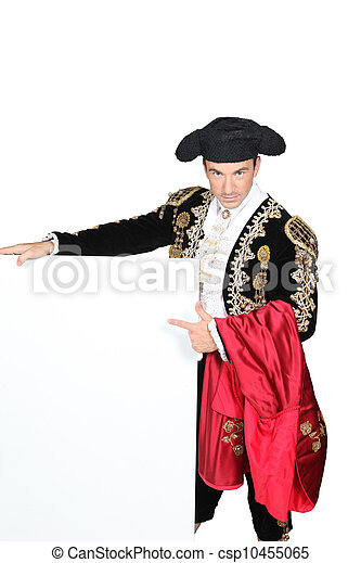 Man dressed as matador stood with blank message board - csp10455065
