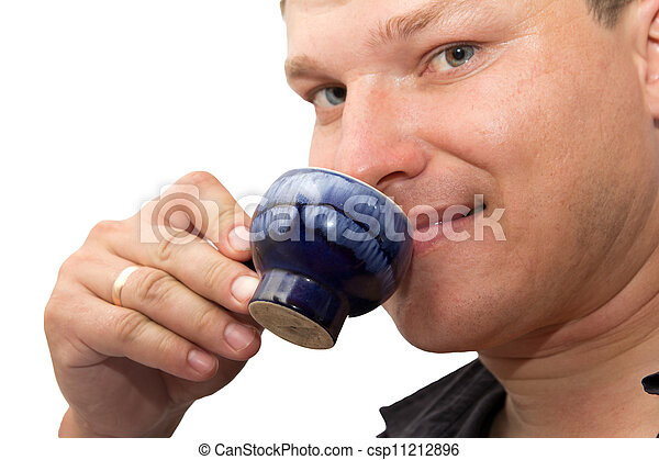 man drinking tea on a white background - csp11212896