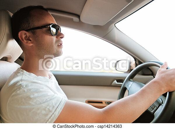 Man driving a car. Inside shoot - csp14214363