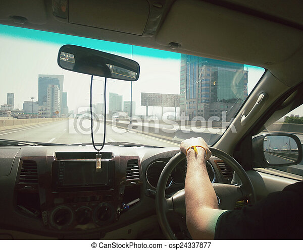 Man driving a car  - csp24337877
