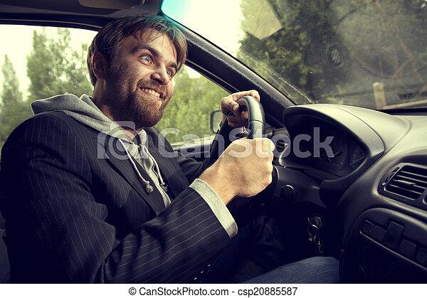 man driving a car - csp20885587