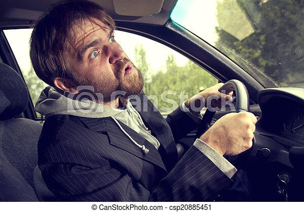 man driving a car - csp20885451