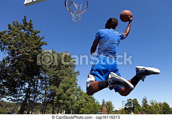 Man Dunking a Basketball - csp16116213