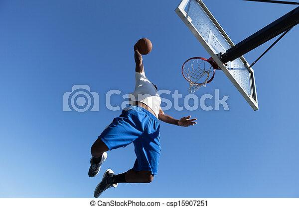 Man Dunking a Basketball - csp15907251