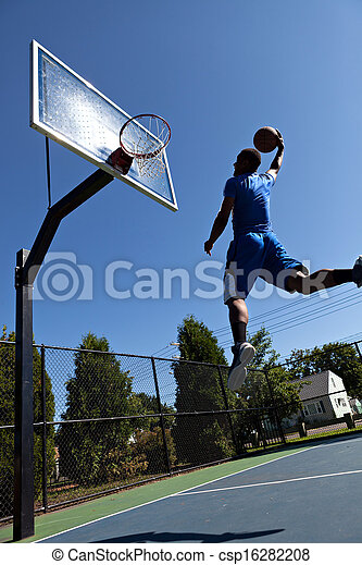 Man Dunking the Basketball - csp16282208