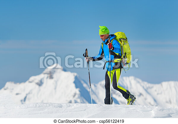 Man during a winter ascent in the mountains - csp56122419