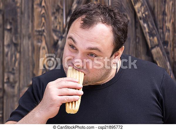 man eating a hot dog - csp21895772
