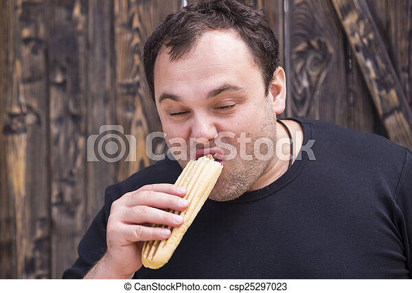 man eating a hot dog - csp25297023
