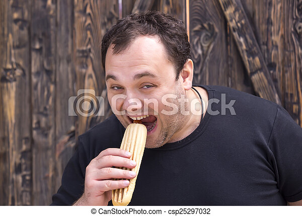 man eating a hot dog - csp25297032