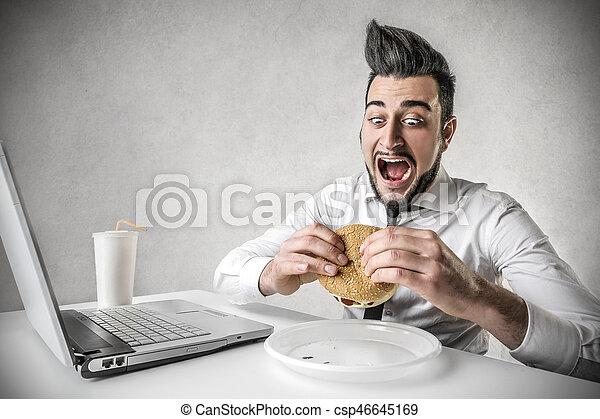 Man eating hamburger - csp46645169
