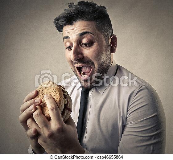 Man eating hamburger - csp46655864