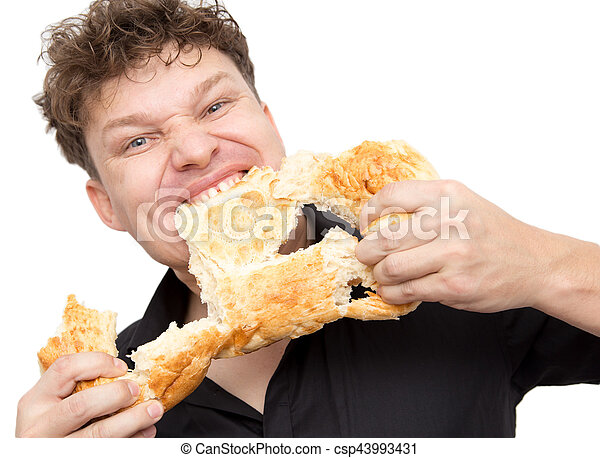 man eats bread on a white background - csp43993431