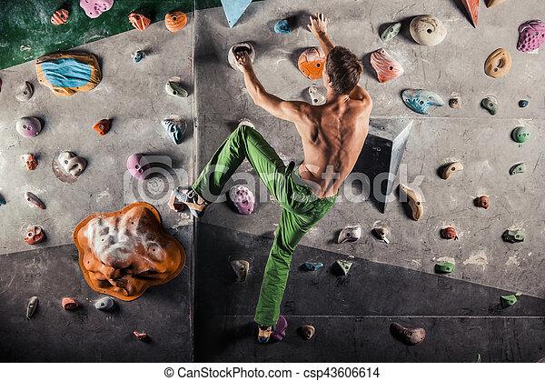 man exercise bouldering and climbing indoor - csp43606614
