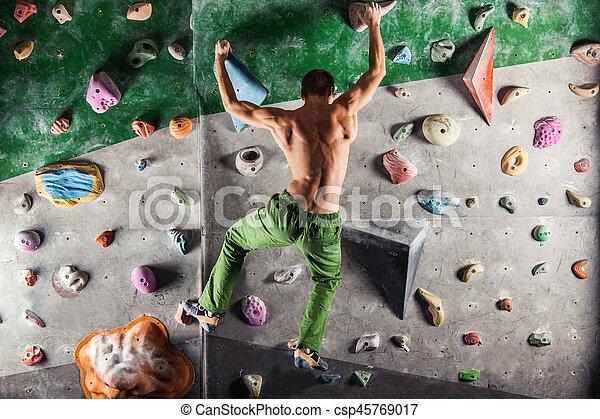 man exercise bouldering and climbing indoor - csp45769017