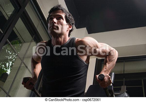 Man Exercising Arm Muscles 4 - csp0672061