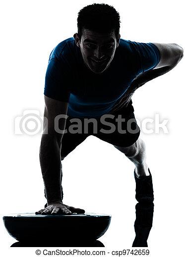 man exercising bosu push ups workout fitness posture - csp9742659