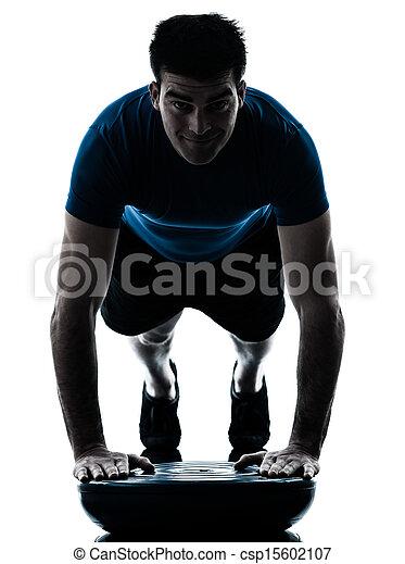 man exercising bosu push ups workout fitness posture - csp15602107