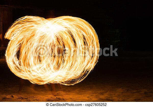 Man Fire Show on the beach  - csp27605252