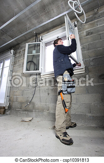 Man fitting double glazing - csp10391813