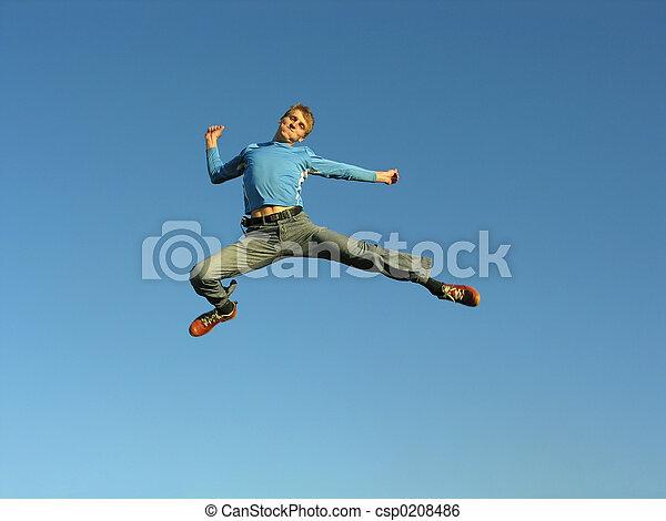 man fly on blue sky - csp0208486