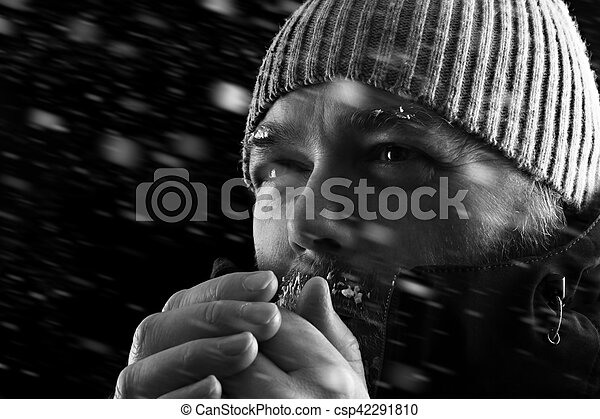 Man freezing in snow storm BW - csp42291810