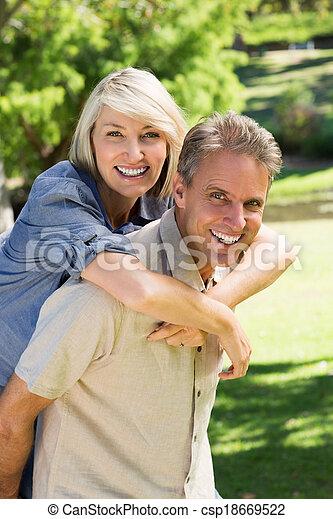 Man giving piggyback ride to woman - csp18669522