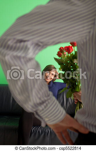 man giving roses to his wife - csp5522814