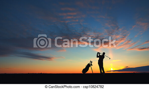 man golf player hit ball to air silhouetted - csp10824782
