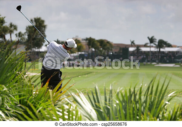 Man golf swing on a golf course - csp25658676