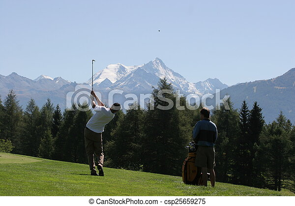 Man golf swing on a golf course - csp25659275