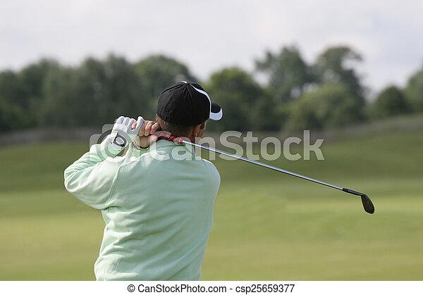 Man golf swing on a golf course - csp25659377