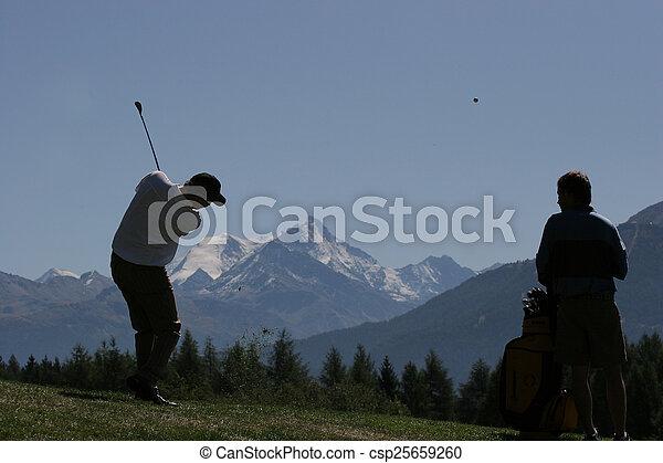 Man golf swing on a golf course - csp25659260