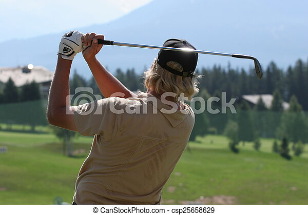 Man golf swing on a golf course - csp25658629