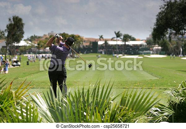 Man golf swing on a golf course - csp25658721