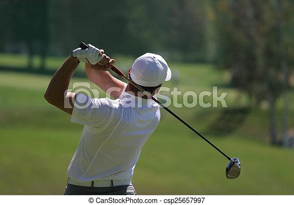 Man golf swing on a golf course - csp25657997